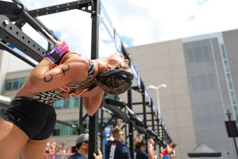 Female Athlete- Chest to Bar Pull-ups (©CrossFit, Inc.)